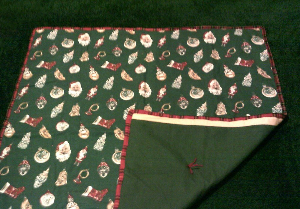 "45"" x 45"" Vintage Green and Red Christmas Flannel, tied, with green flannel backing $50"
